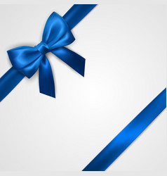 Realistic blue bow with ribbons isolated on white vector