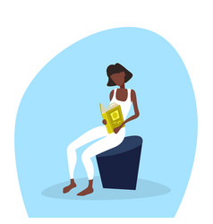 african american businesswoman sitting reading vector image