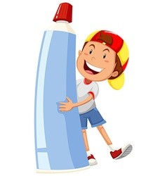 Boy holding large toothpaste vector
