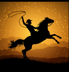 silhouette cowboy with lasso on rearing horse vector image
