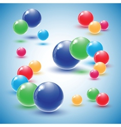 Different colour glass balls on blue background vector image