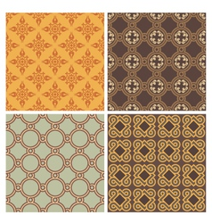 Four decorative symmetric seamless patterns vector image