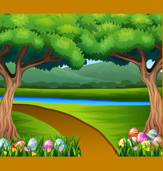 Colored easter eggs in grass with nature backg vector