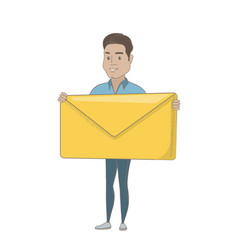 Young hispanic businessman holding big envelope vector
