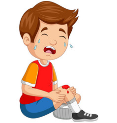 Cartoon little boy crying with scraped knee vector