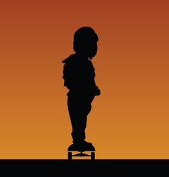 child on skateboard silhouette vector image