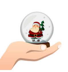 hand holds a glass ball with santa vector image