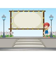 A boy waving his hand near a signboard vector image