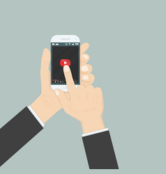 hand holding smartphone with video player vector image