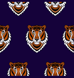Embroidery tiger head seamless pattern vector