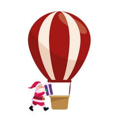 Santa claus and hot air balloon icon vector