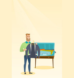 Caucasian man packing clothes in a suitcase vector