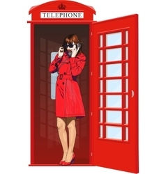 Girl in an English phone booth vector