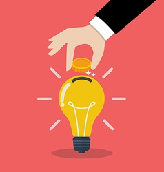 Hand inserting coin in light bulb vector image vector image