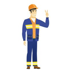 Asian builder showing the victory gesture vector
