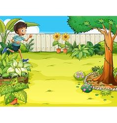 A boy running at the backyard vector