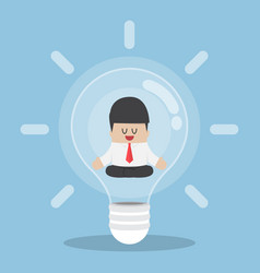 businessman doing meditation inside light bulb vector image