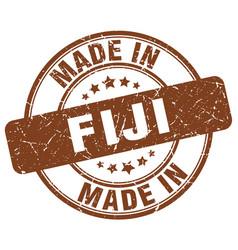 Made in fiji brown grunge round stamp vector