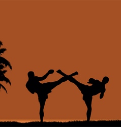 Two people engaged in martial arts on beach vector