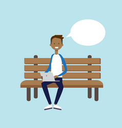 african man using laptop sitting wooden bench chat vector image