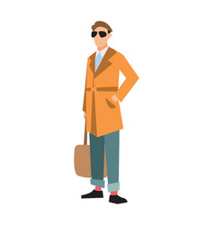elegant fashion man in cardigan and jeans vector image