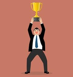Businessman holding up a winning trophy vector