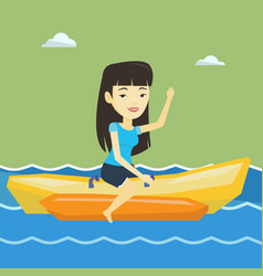 tourists riding a banana boat vector image