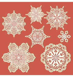 paper cut golden snowflakes vector image