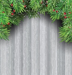 Christmas tree branches on wooden background vector image vector image