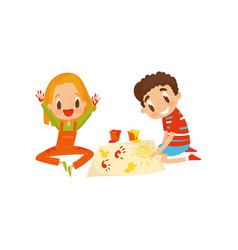 cute little boy and girl sitting on the floor and vector image
