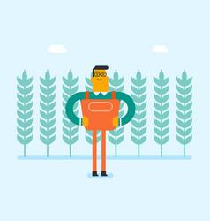 Caucasian farmer standing in a wheat plantation vector
