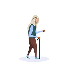 arab old man walking stick using smartphone vector image