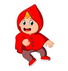 Cute kid witch walking in red cloak vector