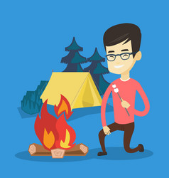 young man roasting marshmallow over campfire vector image