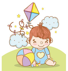 Baby boy with ball and kite toys vector