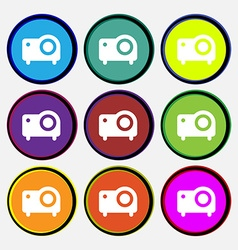 Projector icon sign Nine multi-colored round vector