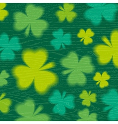 Green background for Patricks day with shamrocks vector