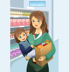 Mother carrying her daughter and grocery bags vector
