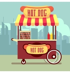 Street food vending cart with hot dogs vector image