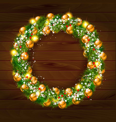 Green christmas wreath decorated with gold balls vector