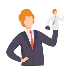 Businessman manipulating employee like puppet vector