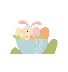 lovely bunny sitting in bowl with colorful eggs vector image