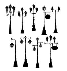 Set of retro street lanterns silhouettes vector image