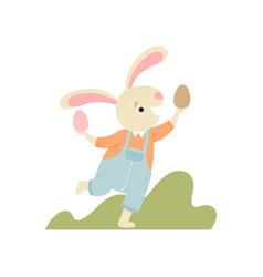 happy cute bunny having fun with eggs happy vector image