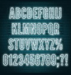 retro white neon alphabet with numbers on brick vector image