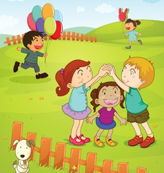 Kids playing in the park vector image vector image