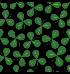 green clover leaves on black background shamrock vector image