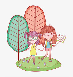 little girls holding hands with book in outdoor vector image