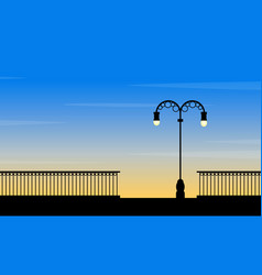 Silhouette of street lamp at sunset landscape vector