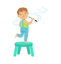 Happy smiling little boy standing on a chair and vector